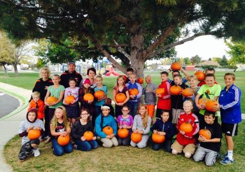 Mapleton Elementary students receive pumpkins from Harward Farms