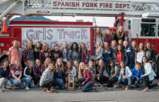 Girls' track celebrates State Championship with fire truck ride